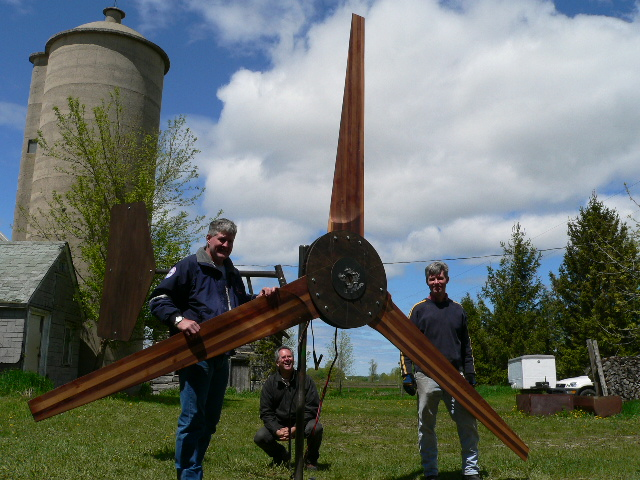 Happy students with 17ft diameter wind rotor they just designed and built. Midwest Renewable Energy Association class.