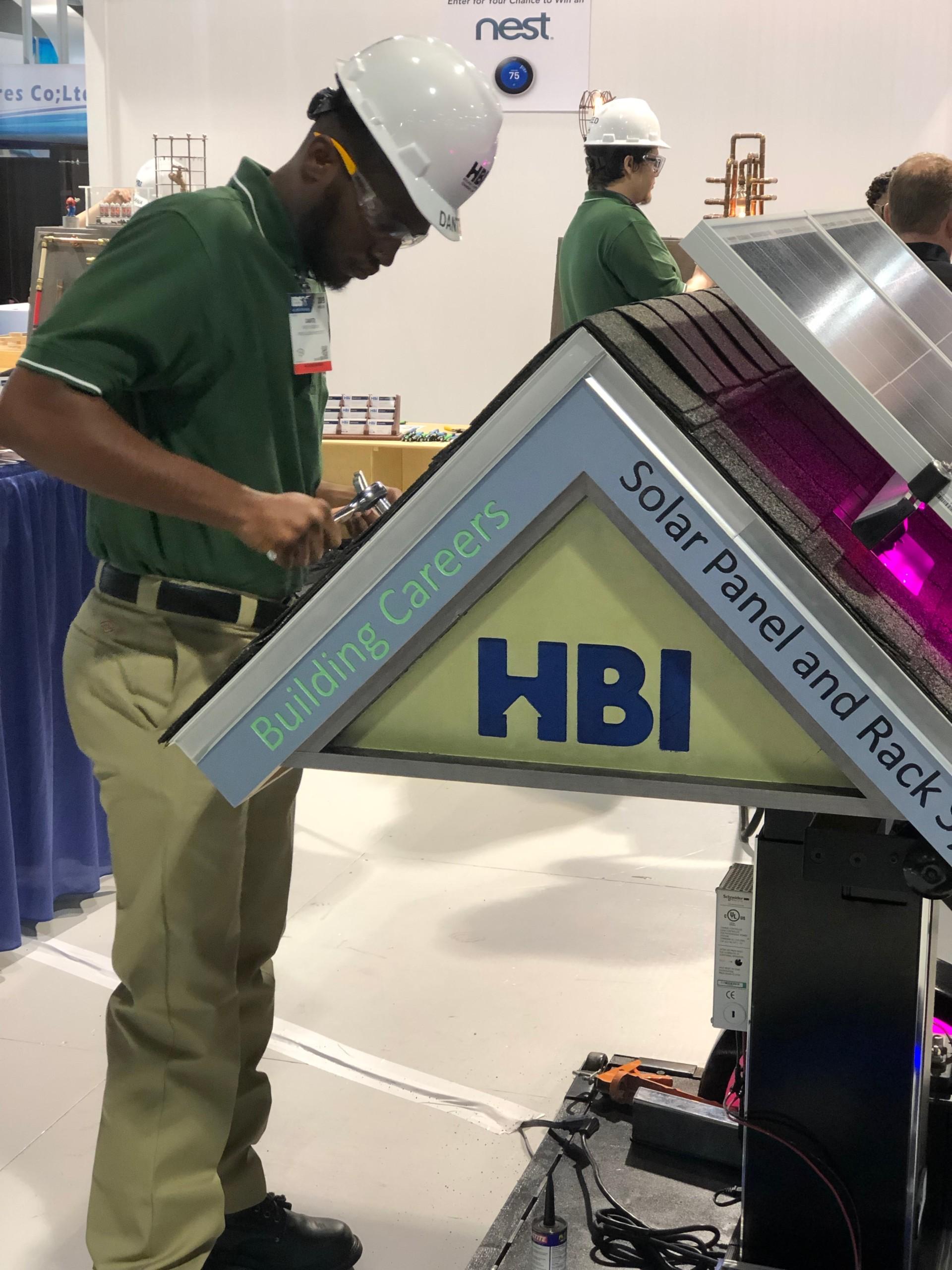Energy Hero HBI demo roof & worker