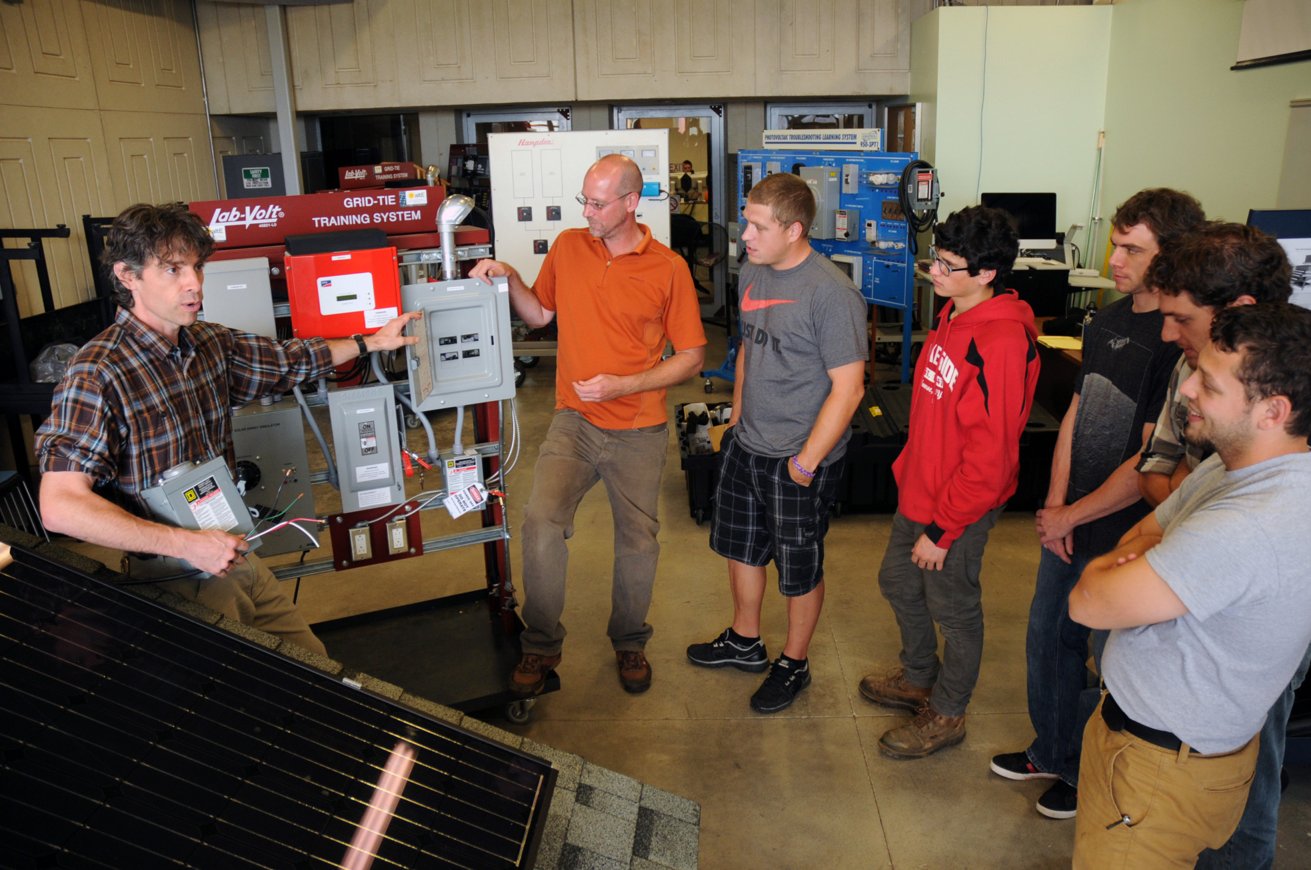 Larry (far left) and Mike (second from left) team-teaching a solar lab to SUNY Sullivan Green Building students  Photo: Karen Ward