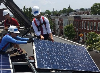 Solar panels are installed atop an East Baltimore row house, July 7, 2015 (Photo courtesy The White House)