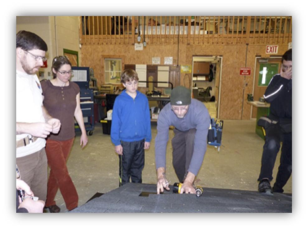 Sluzenski (left) and Paradis (center) teache solar installation to SCRTC building trades students