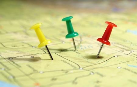 geogrpahical map and three pushpins