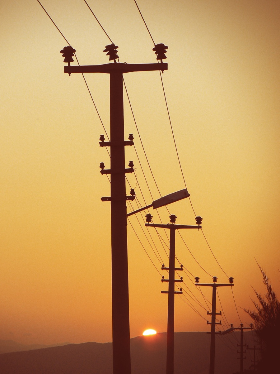 Image of distribution lines (small power lines) at sunset